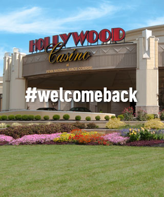 "hollywood casino at penn national racecourse entrance with text ""#welcomeback"""